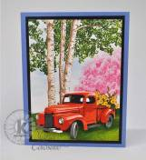 Springtime-Truck-with-flowers-and-Birch-trees